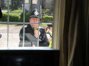 Peek-a-boo: Police having a nose through a window of the Beechwood Hotel